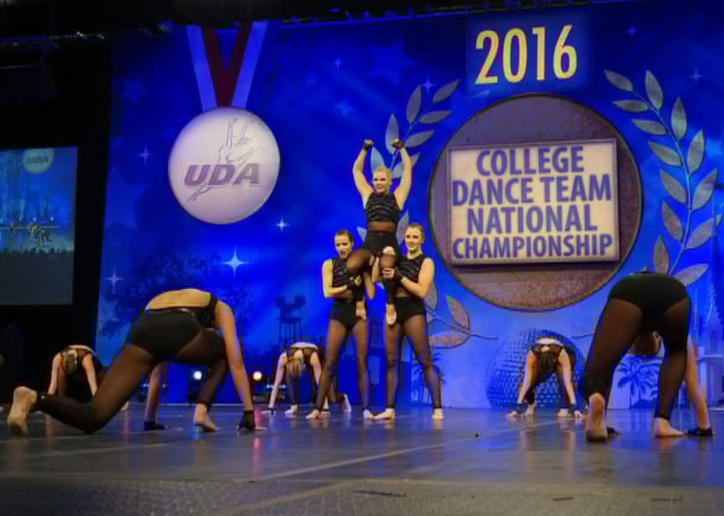 University of S. Thomas Dance team jazz costume, Ronda Rousey, Black edgy costume, low back , crop top and briefs
