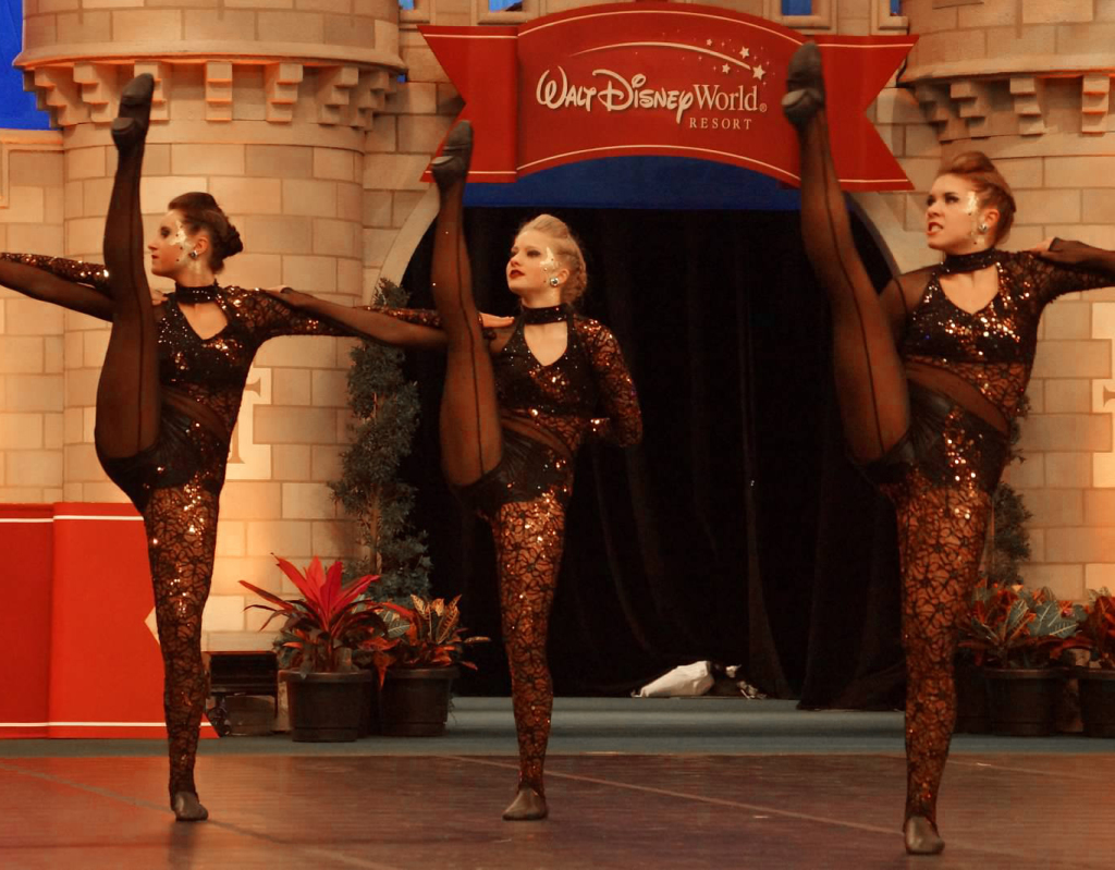 West Fargo Dance Team, The Line Up, high kick, copper and black dance costume, edgy, animalistic, NDTC 2015 Nationals, UDA