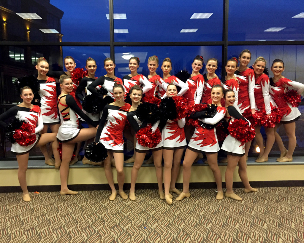 Hortonville pom, black, red and white costume with flame