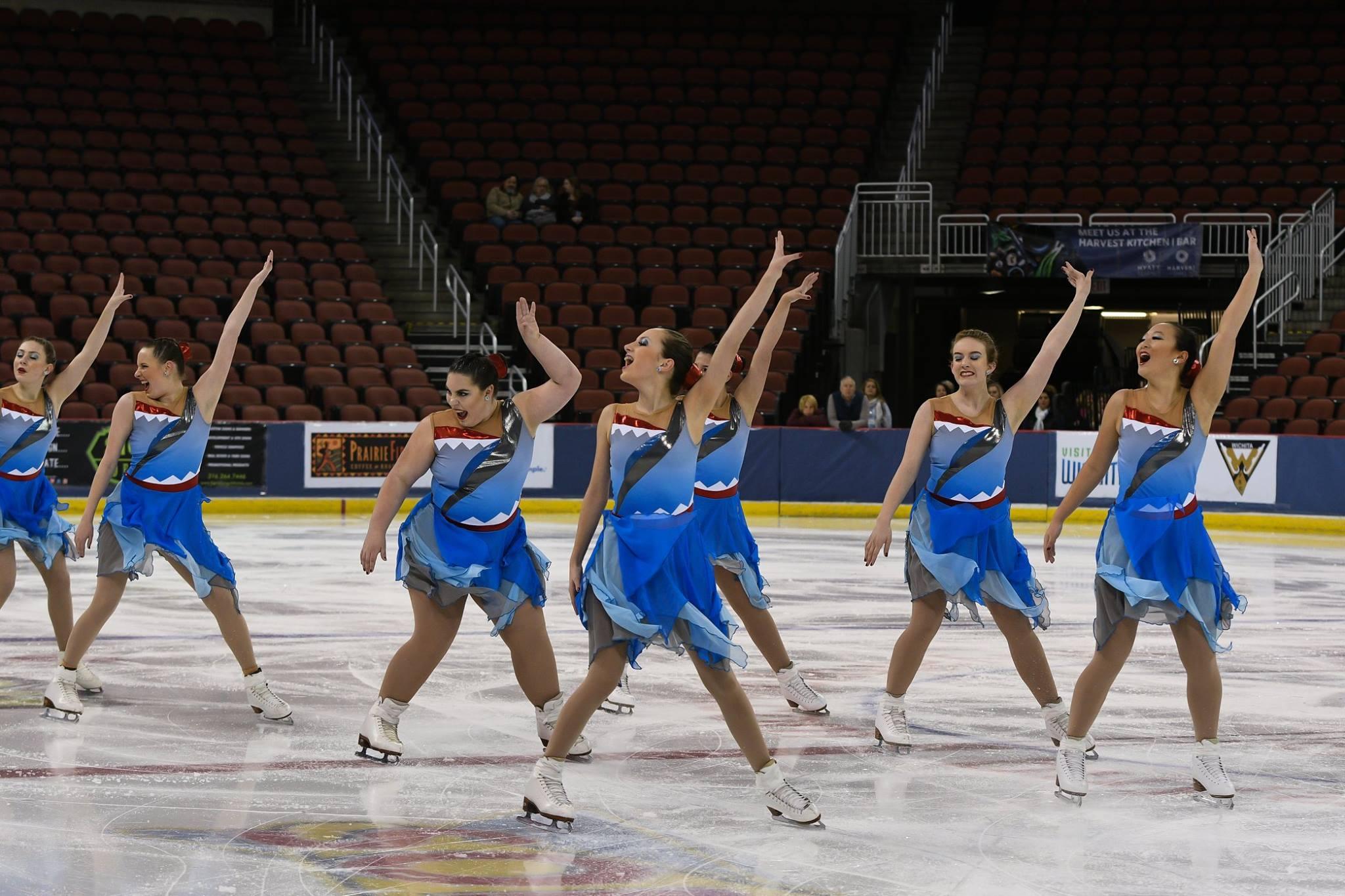 onyx synchronized skating team custom jaws themed skate dresses