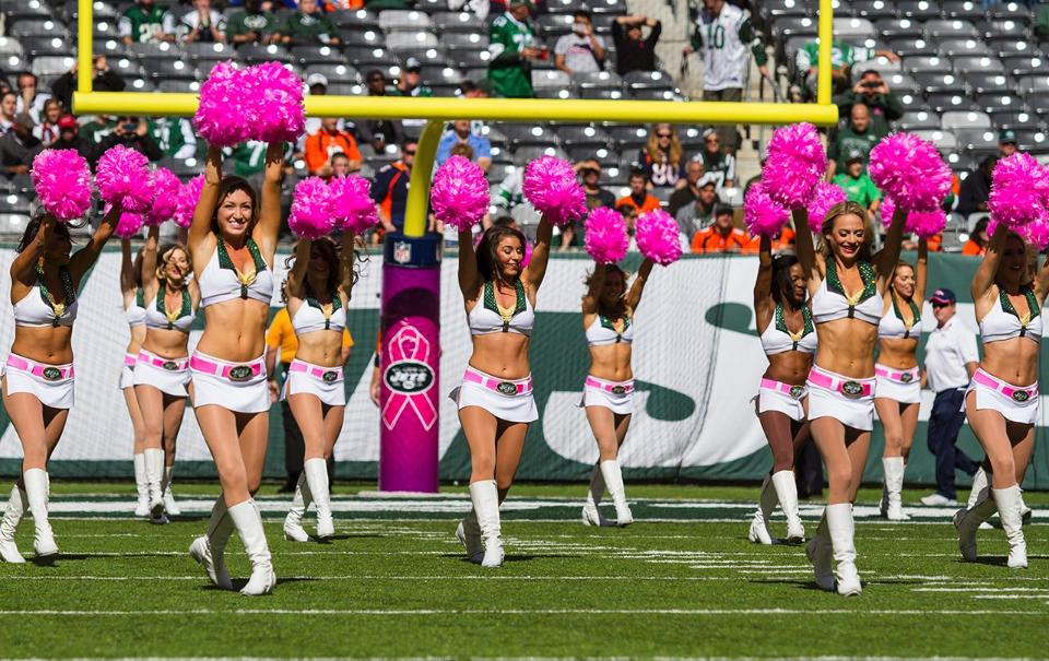 New York Jets Flight Crew cheerleaders in the signature cheer uniform for Breast Cancer awareness month