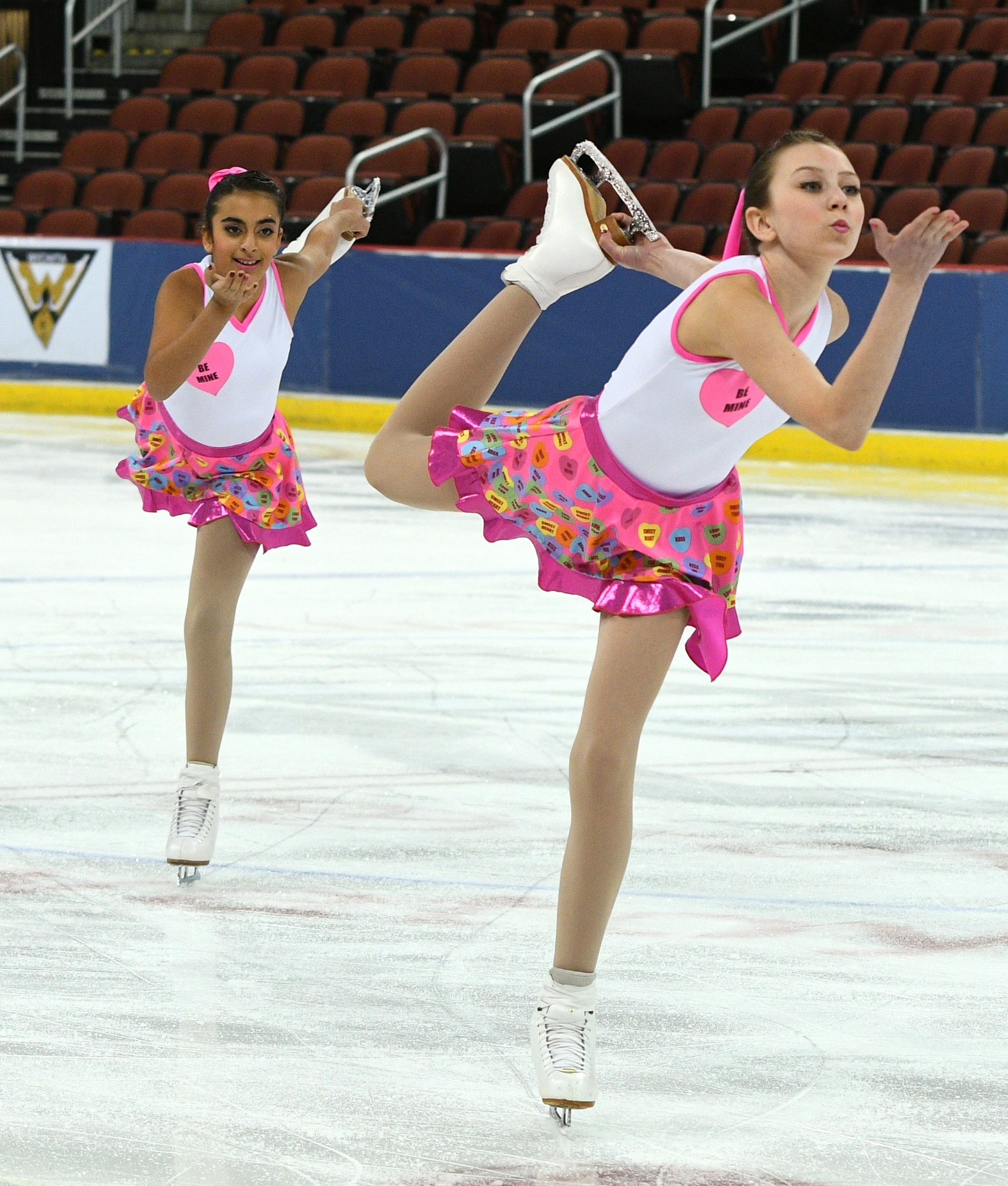 onyx synchronized skating team custom conversation heart themed skate dresses