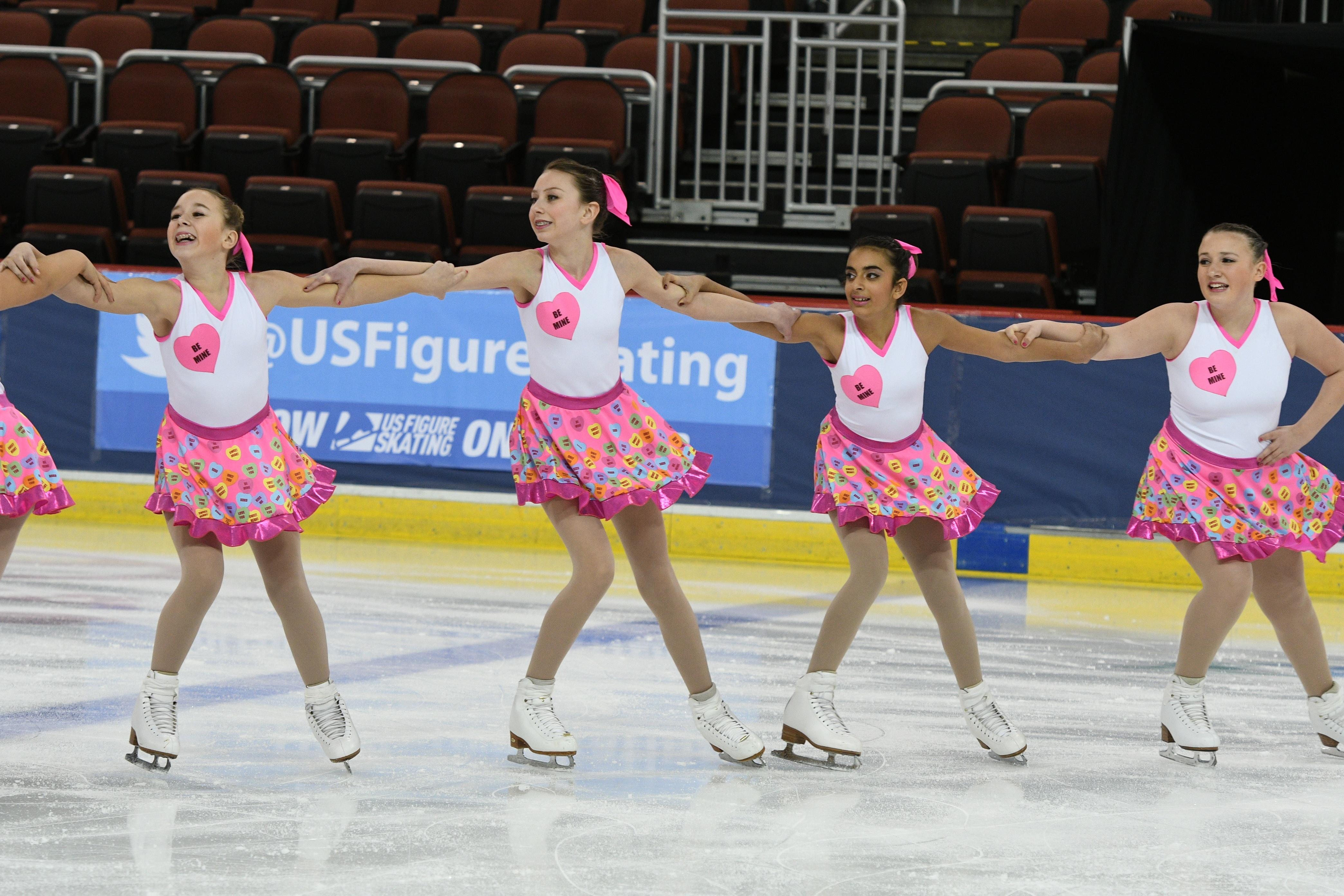 onyx synchronized skating team custom conversation heart themed skate dresses