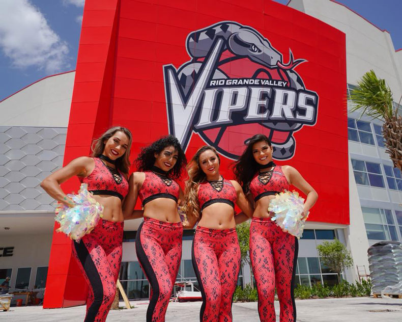 RGV Snake Charmers own the spotlight in their snake print uniforms