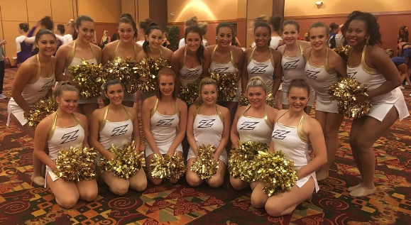 University of Akron in cheer dress at camp