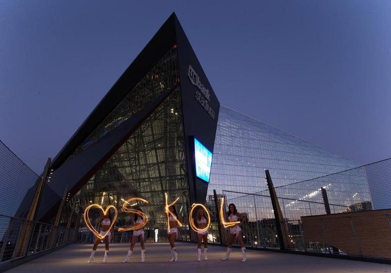 Minnesota Vikings Cheerleaders new uniform in front of US Bank stadium