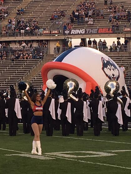 UCONN dance team on the footbal field